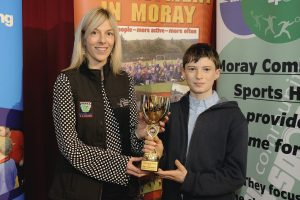 2016 sportMoray Awards Evening at Elgin Town Hall. Junior Sports Athlete Award Presented by: Rosalyn Carruthers (On behalf of Dallas Designs) Winner: Ben Cameron (Athletics) Picture: Daniel Forsyth. Image No.035757